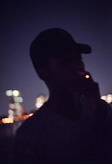 (Abigail Gorden) Tags: dark night city noise grain light smoke hat boy boston portrait