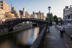 Stone bridge (kmmanaka) Tags: japan nagasaki evening settingsun bicycle tram