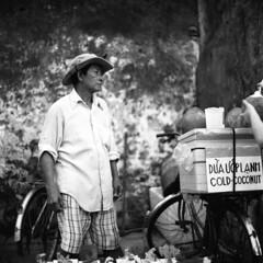 The Coconut Seller (aryel.beck) Tags: rolleiflex 28e xenotar trix kodak iso400 film analogue mediumformat tlr street vietnam coconut asia man seller candid