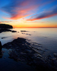 Sunset with Rocks (dcclark) Tags: up upperpeninsula coppercountry michigan sunset lake superior rocks sky clouds shore landscape water dusk outdoor coast cloud