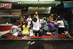 Morning Monks in Hong Kong (Jonathan Kos-Read) Tags: china street morning orange hongkong cool buddha praying monks uncool kneeling cool2 cool5 cool3 cool4 buddhaism uncool2 uncool3 uncool4 uncool5 uncool6 uncool7