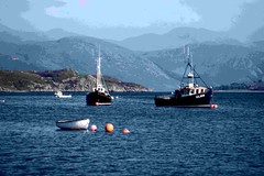 Moored in calm waters. (Mrs Fogey) Tags: sea mountains scotland scenery fishingboats westerross
