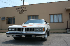 Sherm's (Flint Foto Factory) Tags: auto county city summer urban classic car vintage automobile gm view muscle michigan august front musical chrome american repair instrument intersection pontiac 1977 flint coupe lemans genesee colonnade 2012 canam abody generalmotors intermediate midsize 2door threequarter sherms worldcars dorthwy lapeerrd