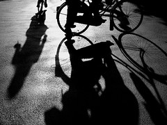 Dutch traffic II (Elios.k) Tags: road shadow people blackandwhite sun sunlight bike bicycle silhouette horizontal lumix three long ride thenetherlands panasonic transportation intersection groningen fiets tz20 pixopolitan