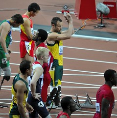 Oscar Pistorius acknowledges the crowd before the men's 100m T44 at the Paralympics, London, 6th September 2012 (Belhaven2011) Tags: uk greatbritain england men london field bronze silver gold athletics nikon track bladerunner stadium wheelchair peacock elite runners blade olympic athletes olympics athlete runner sprint goldmedal blades weir browne paralympics 100m trackandfield london2012 sprinter javelin pistorius oscarpistorius t44 davidweir 100metres 55300 d5000 eliteathlete richardbrowne 1685mm 55300mm jonniepeacock blakeleeper jeromesingleton runnerjpg athleticsjpg londonjpg alanfontelescardosooliveira arnufourie liuzhiming