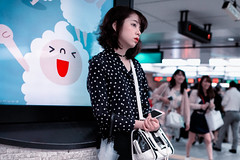 Huh. (Jon Siegel) Tags: nikon d810 sigma 24mm14 sigma24mmf14art 14 sigmaartlens woman girl waiting train station characterillustration japanesecharacter poster ad night evening tokyo japan japanese ebisu