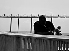 Nap & Fish (Robert S. Photography) Tags: pier coneyisland fishing man cigarette people waiting sea boardwalk portrait bw nyc brooklyn nikon coolpix l340 iso80 september 2016