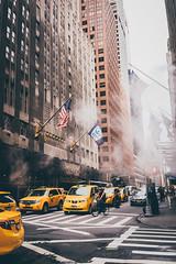 Mist in the street (Ani_Ro) Tags: nordamerika northamerica unitedstatesofamerica usa unitedstates us vereinigtestaatenvonamerika newyork newyorkcity nyc ny manhattan taxi taxis zebrastreifen crosswalk intersection kreuzung strase street hochhaus houses urban urbanpictures stadt city citylife verkehr traffic life leben alltag farbe farben colours colour sony sonyalpha7 alpha7 festbrennweite mist dunst nebel licht schatten lichtschatten light lightshadow shadow