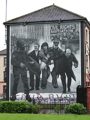 Bogside, Derry - mural depicting Bloody Sunday (gowersaint) Tags: street urban house art history wet public rain soldier death community mural suburban political politics sunday oppression protest culture civil bogside londonderry rights hedge murder violence change northernireland priest bloody suffering injustice communities civilrights struggle derry ulster ordinary interpretation depiction bigotry bloodysunday grudges