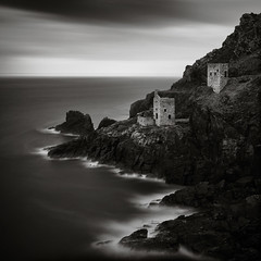 Crowns (Andy Brown (mrbuk1)) Tags: ocean longexposure seascape heritage rock square landscape mono blackwhite rocks mine cornwall surf stonework shoreline cliffs landsend historical bleak rugged botallack kernow thecrowns ndfilters enginehouses