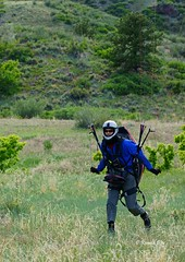 Paraglider ~Benzie at Landing Zone~ (Ron1535) Tags: paraglider paragliding freeflight freeflyer paragliderpilot paragliderlanding glideraircraft soaring soaringaircraft wing sail thermals windcurrents roll pitch yaw flexiblewing mtzion lookoutmountain golden colorado