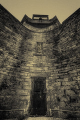 Guard Tower - Eastern State Penitentiary (dbnunley) Tags: door philadelphia monochrome wall canon pennsylvania rusty granite easternstatepenitentiary guardtower prisonwall 60d