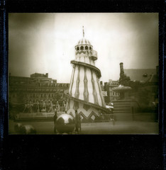 Helter Skelter (pho-Tony) Tags: camera city summer urban black beach netherlands monochrome gardens sepia silver project polaroid seaside peace ride image chocolate sheffield border slide fair system shade 600 instant 1200 asa polaroidspectra spectra funfair impossible ip helterskelter pz helter skelter blackframe whiteknuckle polaroid1200 imagesystem autaut instantpicture polaroidimagesystem polaroidcorporation silvershade impossibleproject theimpossibleproject pz600