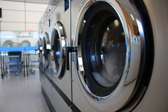 Saturday morning after the washer broke down for good (timlewisnm) Tags: wash laundry laundromat washer