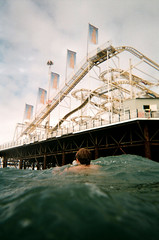 Snap Sights (danielcane) Tags: sea sky people man colour film swimming swim 35mm person sussex amusement pier seaside brighton waves underwater ride wind hove wave snap 200iso iso negative 35mmfilm 200 figure swimmer vista plus rides lonely rollercoaster analogue agfa figures eastsussex amusements sights waterproof palacepier colournegative c41 brightonandhove agfaphoto snapsights agfaphotovistaplus