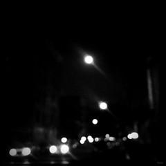 i'm a rabbit in your headlights. (jdx.) Tags: street nyc newyorkcity light urban blackandwhite moon eastvillage newyork blur art cars square landscape lights cityscape streetlights lowereastside fullmoon format grayscale avenuea iphone jdx iphoneography hipstamatic