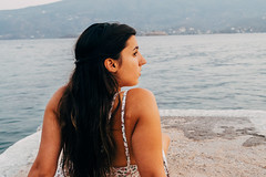 (Giorgos Balt) Tags: girl woman human portrait landscape seascape hair breeze wind greece vsco 35mm