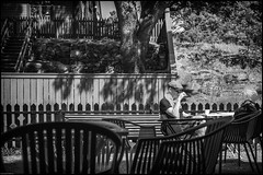 Morning coffee (Christopher Anderzon) Tags: street bw house man coffee caf breakfast scarf fence chair crossword oldman