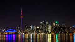 Toronto at night (Deniz Kilicci) Tags: sony city sonya6000 sel35f18 toronto llights night sonyalpha buildings tower cntower skyline water architecture outdoor longexposure