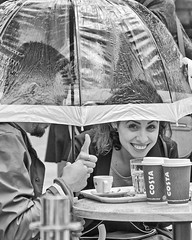 Keen-eyed (sasastro) Tags: streetphotography streets people couple rain umbrella blackwhite mono pentaxk5iis smcpentaxda18135mm colchester essex uk