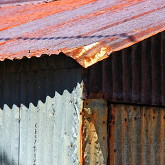 Chuy's Shed [Explore  23 Aug 2016] (studioferullo) Tags: abstract beauty bright light building buildings colorful contrast country decay old design detail downtown house metal minimalism outdoor outside pattern pretty rust serene shadow shadows line lines sunny sunshine sunlight street texture town village weathered bisbee arizona shed blue red gray gold yellow brown curve curves