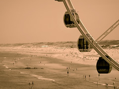 Ferris wheel and beach , Scheveningen , the Netherlands (STEHOUWER AND RECIO) Tags: parish wheel parishwheel beach people dunes view scenery coast coastal water sand scene sepia waves wave salt play summer landscape scheveningen netherland dutch holland hollands uitzicht reuzenrad vip high children women man family bathing wet sunbathing lines tourism popular busy many mensen veel lots restaurant boats fun fuji sl1000 nederland denhaag sgravenhage ferris ferriswheel