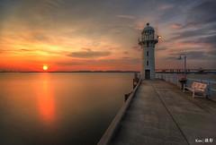 Lighthouse Sunset (Ken Goh thanks for 3 Million views) Tags: sunset sky reflection water smooth silhouette lighthouse raffles marina pentax k1 sigma 1020