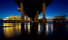 Scheveningen Pier (Haags Uitburo) Tags: lighting blue sea holland building beach water netherlands dutch architecture night strand speed lights la pier jump colorful meer europa europe long exposure slow scheveningen centre den north nederland silk noordzee zee denhaag hague hour promenade shutter architektur bungy colourful avond haag effect paysbas nederlands thehague haye laia olanda piles architectuur avondlicht haya niederlande schemering kust lange the haagse blaue sluitertijd vandervalk stunde haags scheveningse haia a uitburo uitbureau haagsuitburo