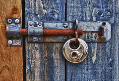 Padlock on old weather beaten shed (JamboEastbourne) Tags: blue skye weather yellow gold scotland wooden rust shed beaten isle paddlock
