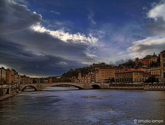 In Lyon (amalia lam) Tags: street city travel bridge blue light red sky urban white black france reflection tourism colors architecture clouds alpes canon river french photography town europa europe waves colours shadows lyon exploration buldings nationalgeographic rhone distortions amalialampri amalialam