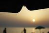 vita da spiaggia (mafratra) Tags: sea italy italia tramonto mare salento puglia spiaggia ombrellone ugento rivadiugento racchettoni