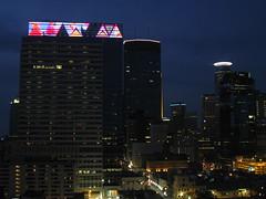 Downtown Minneapolis Skyline (Anne Abscission) Tags: city urban minnesota skyline night buildings lights evening downtown streetlights scenic minneapolis powershot glowing lightshow birdseyeview targetcenter lightdisplay minneapolisskyline