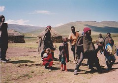 Lesotho, South Africa 2000 004 (Dorsetized) Tags: family sky landscape happy african tribal hills huts together remote wilderness wellies undeveloped contented localcustom