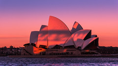 Sydney Opera House (Myrialejean) Tags: therocks newsouthwales australia au sydney opera house sydneyoperahouse sunset orange blue red water roof building sky architecture outdoor sea waves gradient evening dusk venue arts distinctive famous landmark jrnutzon jrn utzon josephcahill bennelongpoint sydneycove farmcove operaaustralia sydneysymphonyorchestra unescoworldheritagesite expressionist modern concrete joansutherlandtheatre d7200 nikon