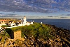 The lighthouse and Wine Tower at Kinnaird Head, Fraserburgh (iancowe) Tags: kinnaird head kinnairdhead lighthouse fraserburgh castle wine tower winetower aberdeenshire north sea moray firth drone aerial sunrise dawn morning nlb northernlighthouseboard stevenson museum scottish lighthouses cloud clouds dji phantom 4