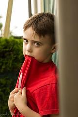 La timidezza.. (paolotrapella) Tags: portrait ritratto persone bambino rosso red profilo