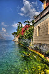 Malcesine coastline (Poynton Robbo (www.clickar.co.uk)) Tags: italy malcesine sea water flowers sky blue