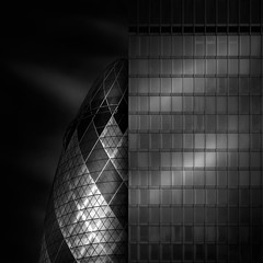 hidden (Julia-Anna Gospodarou) Tags: city uk england sky urban blackandwhite bw abstract building london tower monochrome lines architecture clouds contrast square daylight zoom patterns sony curves perspective hidden architect normanfoster tall streaks juxtaposition tamron gherkin highlight 30stmaryaxe cityoflondon modernbuilding curtainwall glasswall blacksky longlens eggshape wallcladding juliaannagospodarou