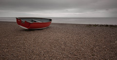 Red boat, Dunwich (Digsys Diner) Tags: red sea beach boat town suffolk shoreline overcast medieval pebble shore northsea maritime storms reclaimned