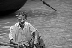 A Boatman (Tipu Kibria~~BUSY~~) Tags: portrait people water face work canon river eos boat poor lifestyle dhaka bangladesh boatman struggle sadarghat buriganga canonef70200mmf4lisusm canoneos5dmarkii