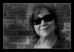She (CameraOne) Tags: she portrait blackandwhite woman brick texture sunglasses female raw framed fade canon5d merge camerone cs5 memorycorner memorycornerportraits