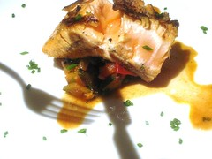 Shadow Salmon over Heirloom tomatoes and fresh her