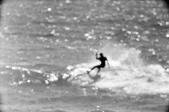 kitesurfing summer sessions, santa cruz, august 2012 [#026605] (Jeff Merlet Photography) Tags: ocean california leica sea sky bw usa santacruz sun kite man film beach water silhouette sport analog landscape blackwhite bucket published surf day afternoon pacific wind kodak action outdoor surfer 05 board wave windy sunny blowing august snap surfing kitesurfing spray riding negative 400 surfboard 135 rider swell kitesurf vignette strapless smack kiting 2012 visoflex rpl trix400 fullbody kiteboarder leicam6ttl offthelip windswell scphoto visoflexiii 201208 richardphotolab thelanetowaddell jeffmerletphotography photojeffmerletcom 20120809 kitesurfingsummersessions telyt56068 026605 r0266 rpl4490