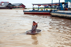 Floating Salesman (Ebola Cereal) Tags: travel lake girl canon asia cambodia southeastasia floating tub 5d sell sales tonlesap floatingvillage