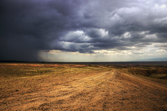 rain on desert kazakhstan (mariusz kluzniak) Tags: rain rock clouds dark landscape sand asia view desert flat sony incoming alpha heavy incredible kazakhstan 77 steppe a77