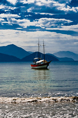 Ubatuba, Sao Paolo Brazil (Environmental Artist) Tags: ocean sea brazil sky sun beach nature water sunshine clouds boat nationalpark scenery waves peaceful atmosphere atlantic exotic naturereserve attractive stunning serene pure tranquil sustainability pristine saopaolo ilhaanchieta colorphotoaward