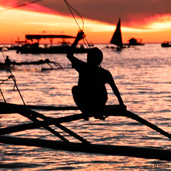 Philippines Sunset (Ed Kruger) Tags: ocean travel blue sunset red sea sky people orange sun holiday seascape reflection water sunshine silhouette yellow clouds island evening boat fishing fisherman october asia southeastasia waves ship asians fishermen yacht horizon philippines wave sunny vessel boating boracay fishingboat filipinas allrightsreserved admiralty caticlan banka yachting philippinen skyphoto cargoship 2011 travelasia peopleofasia フィリピン 菲律宾 asiancities shipphoto earthasia филиппины edkruger asiancountries photoofocean cultureofasia photosofasia photosofthesky
