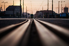 corner pocket (ewitsoe) Tags: tram lowdof rail linesw symmetry ewitsoe lines cityscape poznan poland nikond80 35mm street city horizon sunrise summer urban citylife trams train travel commuting pedestrian polska