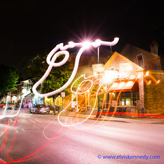 100 Days of Summer #84 - Bump in the Night (elviskennedy) Tags: 25 25mm a7 a7r a7rii a7rm2 batis blue blur buildings bump caramel city coffee dark downtown downtowncedarburg elvis elviskennedy fiddleheads kennedy letters lighttrails lights longexposure motion movement night orange outdoor outside overlay red scenic script secret secretmessage sign signs sony street streetlamp streetlights swirl town traffic trails trees village wi wisconsin writing wwwelviskennedycom zeiss cedarburg unitedstates us bmw z3