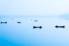 Shadows (ravalli1) Tags: myanmar amarapura boats lake burma birmania blue fog mandalay people dailylife fisherman work